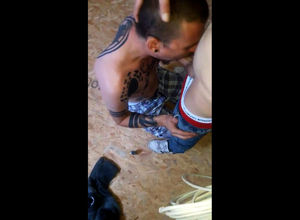 Tatted homo victim fellate on knees