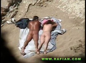 Naturist duo nails on beach in..