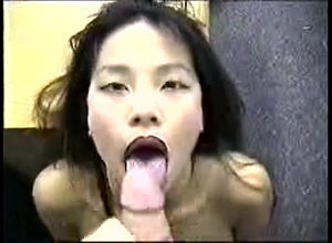 Japanese gal deep-throats and gets a..