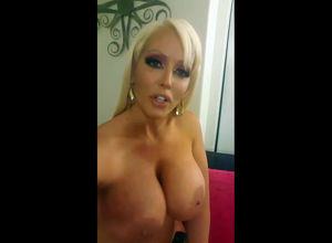 Blonde MILF with huge boobs invites to..