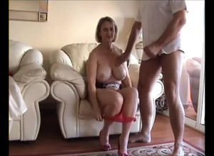 Buxomy mature unclothes all nylons to..