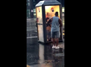 Brit duo pounds in telephone booth in..